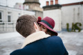 Bride and Groom kissing on rooftop