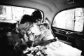 Bride and Groom and flowergirl in taxi